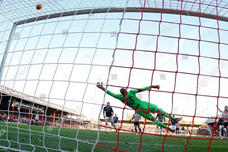 Millwall's Goalkeeper Ben Amos beaten, but saved by the bar during the EFL Sky Bet Championship match between Brentford and Millwall at Griffin Park, London