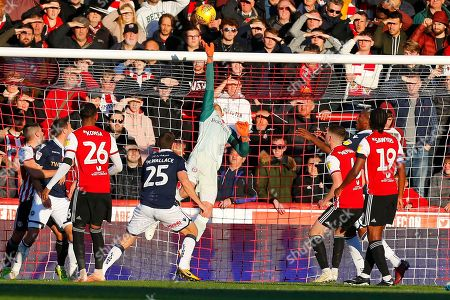 Brentford's Goalkeeper Daniel James Bentley tips over during the EFL Sky Bet Championship match between Brentford and Millwall at Griffin Park, London