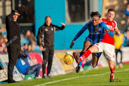 Gillingham FC midfielder Regan Charles-Cook (11) and Fleetwood Town midfielder Jason Holt (4) during the EFL Sky Bet League 1 match between Gillingham and Fleetwood Town at the MEMS Priestfield Stadium, Gillingham