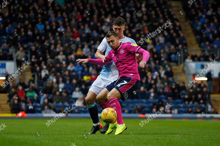 Queens Park Rangers midfielder Luke Freeman shields the ball from Blackburn Rovers Richard Smallwood during the EFL Sky Bet Championship match between Blackburn Rovers and Queens Park Rangers at Ewood Park, Blackburn