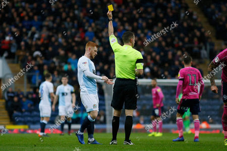 Stock Image of Referee Peter Bankes shows a yellow card to Blackburn Rovers Harrison Reed during the EFL Sky Bet Championship match between Blackburn Rovers and Queens Park Rangers at Ewood Park, Blackburn