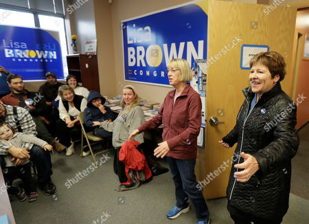 Lisa Brown, right, the Democrat challenging Rep. Cathy McMorris-Rodgers, R-Wash., for her 5th Congressional District seat, arrives with U.S. Sen. Patty Murray, D-Wash., second from right, to give a pep talk to volunteers at Brown's campaign office in Spokane, Wash