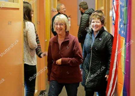 Lisa Brown, right, the Democrat challenging Rep. Cathy McMorris-Rodgers, R-Wash., for her 5th Congressional District seat, walks with U.S. Sen. Patty Murray, D-Wash., left, as they arrive to give a pep talk to volunteers at Brown's campaign office in Spokane, Wash