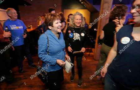 """Democrat Lisa Brown, center-left, greets supporters following a public reading of """"Seven Prayers to Cathy McMorris Rodgers,"""" a chapbook of poems by Kate Lebo directed at Brown's opponent in the 5th Congressional District election, U.S. Rep. Cathy McMorris-Rodgers, R-Wash., in Spokane. Wash"""