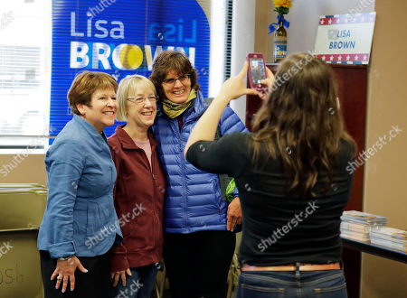 Lisa Brown, left, the Democrat challenging Rep. Cathy McMorris-Rodgers, R-Wash., for her 5th Congressional District seat, poses for a photo with a supporter, right, and U.S. Sen. Patty Murray, D-Wash., center, following a pep talk with Murray to volunteers at Brown's campaign office in Spokane, Wash