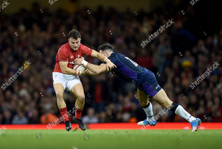Luke Morgan of Wales is tackled by Alex Dunbar of Scotland