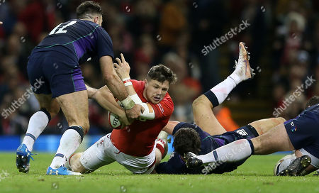 Steff Evans of Wales is tackled by Alex Dunbar of Scotland.