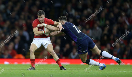 Luke Morgan of Wales is tackled by Alex Dunbar of Scotland.