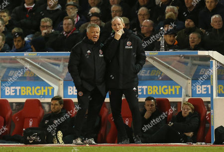 Sheffield United manager Chris Wilder and assistant Alan Knill look on dejected
