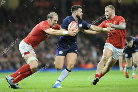 Alex Dunbar of Scotland is tackled by Alun Wyn Jones of Wales and Ross Moriarty of Wales