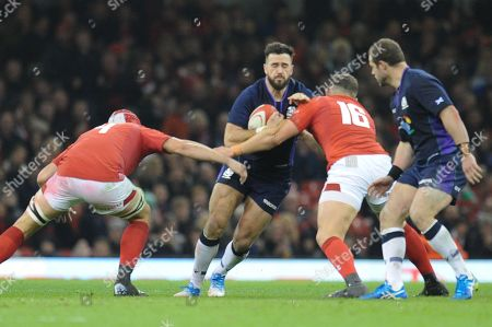 Alex Dunbar of Scotland is tackled by Cory Hill of Wales and Elliot Dee of Wales