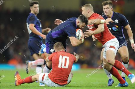 Alex Dunbar of Scotland  is tackled by Gareth Anscombe of Wales