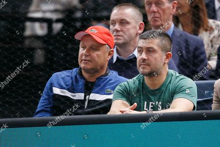 Novak Djokovic's coach Marian Vajda watches