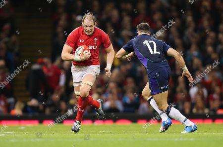 Alun Wyn Jones of Wales takes on Alex Dunbar of Scotland