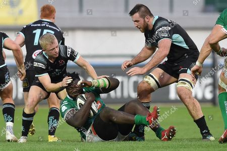 Stock Photo of Benetton vs Ulster. Benetton's Derrick Appiah tackled by Ulster's Dave Shanahan and Alan O?Connor