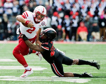 022f193f6 Ohio State Buckeyes safety Brendon White (25) tackles Nebraska Cornhuskers  quarterback Adrian Martinez ...