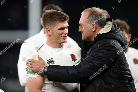 Owen Farrell of England with team manager Richard Hill after the match