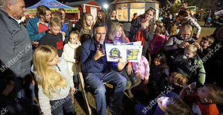 Mitt Romney, Ann Romney. Former GOP presidential nominee Mitt Romney and his wife Ann read a children's book during scary tales and smores bonfire at Cornbelly's Corn Maze & Pumpkin Fest at Thanksgiving Point in Lehi, Utah. Romney is stumping for fellow Republican candidates as he sails toward a likely victory Tuesday, Nov. 6, in the race for a U.S. Senate seat from Utah and an official return to public office
