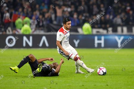 Stock Photo of Lyon's Rafael Pereira Da Silva, right, challenges for the ball with Bordeaux' Yann Karamoh, left, during their French League One soccer match in Decines, near Lyon, central France