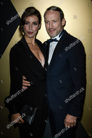 Wotan Wilke Moehring (R) and partner Cosima Lohse pose upon their arrival for the 25th Opera Gala of the German Aids Foundation in Berlin, Germany, 03 November 2018.