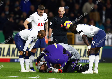 Stock Picture of Mousa Dembele of Tottenham Hotspur feels the pain from an injury