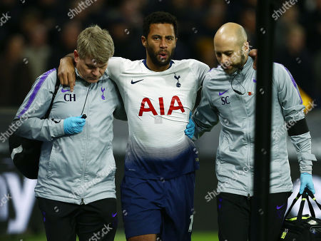 Stock Image of Mousa Dembele of Tottenham Hotspur leaves the game through injury