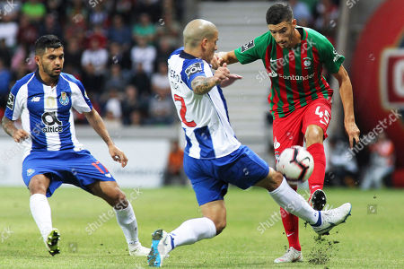 Maritimo's Fabio China (R) in action against FC Porto's Maxi Pereira (C) during their Portuguese first league soccer match between Maritimo and FC Porto held at Barreiros Stadium, Funchal, Portugal, 03 November, 2018.