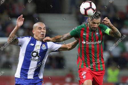 Maritimo's Danny (R) in action against FC Porto's Maxi Pereira (L) during their Portuguese first league soccer match between Maritimo and FC Porto held at Barreiros Stadium, Funchal, Portugal, 03 November, 2018.