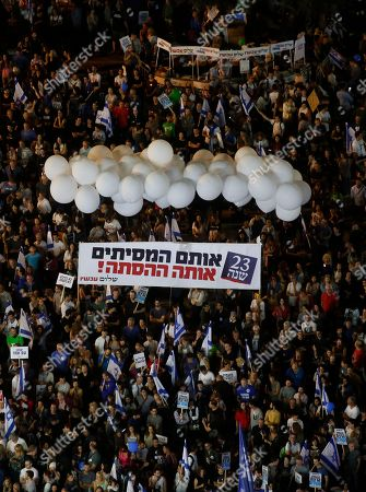Stock Image of People gather to commemorate the 23th anniversary of the assassination of former Israeli Prime Minister Yitzhak Rabin, on Rabin Square in Tel Aviv, Israel, 03 November 2018 evening. Yitzhak Rabin was assassinated at a peace rally in support of the Oslo Accords on 04 November 1995, by an ultra-Orthodox Jewish gunman. The day marks the 23rd anniversary since the assassination according to the Hebrew calendar.