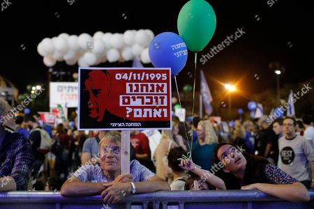 Stock Picture of People gather to commemorate the 23th anniversary of the assassination of former Israeli Prime Minister Yitzhak Rabin, on Rabin Square in Tel Aviv, Israel, 03 November 2018 evening. Yitzhak Rabin was assassinated at a peace rally in support of the Oslo Accords on 04 November 1995, by an ultra-Orthodox Jewish gunman. The day marks the 23rd anniversary since the assassination according to the Hebrew calendar.