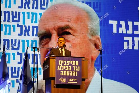 Israeli politician and leader of the Labor party, Avi Gabbay (C), speaks during a ceremony on the occasion of the 23th anniversary of the assassination of former Israeli Prime Minister Yitzhak Rabin, on Rabin Square in Tel Aviv, Israel, 03 November 2018 evening. Yitzhak Rabin was assassinated at a peace rally in support of the Oslo Accords on 04 November 1995, by an ultra-Orthodox Jewish gunman. The day marks the 23rd anniversary since the assassination according to the Hebrew calendar.