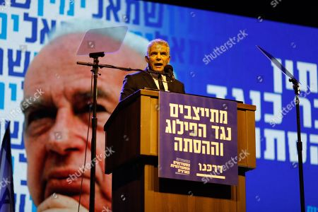 Israeli politician and leader of the Yesh Atid party, Yair Lapid (C), speaks during a ceremony on the occasion of the 23th anniversary of the assassination of former Israeli Prime Minister Yitzhak Rabin, on Rabin Square in Tel Aviv, Israel, 03 November 2018 evening. Yitzhak Rabin was assassinated at a peace rally in support of the Oslo Accords on 04 November 1995, by an ultra-Orthodox Jewish gunman. The day marks the 23rd anniversary since the assassination according to the Hebrew calendar.