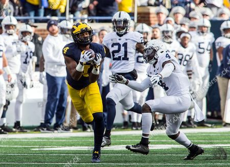 Michigan wide receiver Nico Collins, left, makes a 47-yard reception, defended by Penn State safety Nick Scott (4) in the second quarter of an NCAA college football game in Ann Arbor, Mich