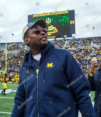 Former Michigan basketball player Chris Webber, right, on the Michigan Stadium field prior to an NCAA college football game against Penn State in Ann Arbor, Mich., . Michigan is making Webber an honorary captain for the game