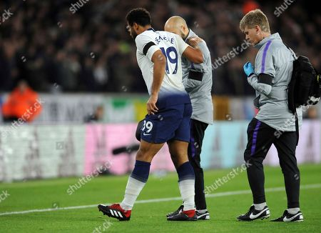 Tottenham's Mousa Dembele, front left, leaves the field during the English Premier League soccer match between Wolverhampton Wanderers and Tottenham Hotspur at the Molineux Stadium in Wolverhampton, England