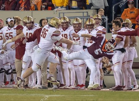 Virginia Tech quarterback Ryan Willis is shoved out of bounds by Boston College's Ray Smith during an NCAA college football game in Blacksburg, Va