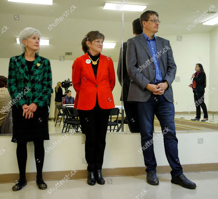 Stock Image of Laura Kelly, Sharice Davids, Kathleen Sebelius, Brian McClendon. U.S. House Democratic candidate Sharice Davids, right, is reflected in a mirror while former Kansas Gov. Kathleen Sebelius, left, Democratic candidate for Kansas Governor, Laura Kelly, center, and Kansas Democratic Secretary of State candidate Brian McClendon watch during a campaign stop at the New Bethel Church, in Kansas City, Kan. Davids is challenging incumbent Republican Rep. Kevin Yoder for his seat representing Kansas' 3rd district