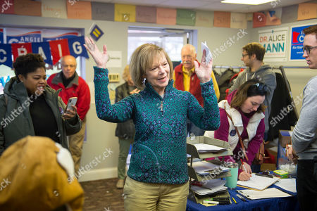 Democrat Sen. Tina Smith (C), who is campaigning for the US Senate, talks with campaign volunteers in Burnsville, Minnesota USA, 03 November 2018. Smith is challenging Republican Karin Housley for the Senate seat formerly held by Al Franken in the 06 November midterm elections.