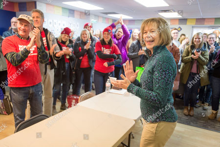 Democrat Sen. Tina Smith (R), who is campaigning for the US Senate, talks with campaign volunteers in Burnsville, Minnesota, USA, 03 November 2018. Smith is challenging Republican Karin Housley for the Senate seat formerly held by Al Franken in the 06 November midterm elections.