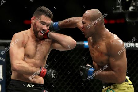 Chris Weidman, left, blocks a shot from Ronaldo Souza during the second round of a middleweight mixed martial arts bout at UFC 230, at Madison Square Garden in New York
