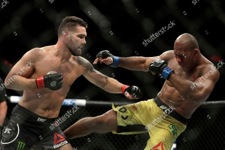 Chris Weidman, left, lands a punch on Ronaldo Souza during the second round of a middleweight mixed martial arts bout at UFC 230, at Madison Square Garden in New York