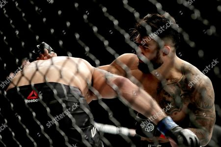 Lyman Good, right, throws a punch at Ben Saunders during the first round of a welterweight mixed martial arts bout at UFC 230, at Madison Square Garden in New York