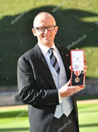 Mark Rowley poses with his medal after being created a Knights Bachelor (Knighthood)