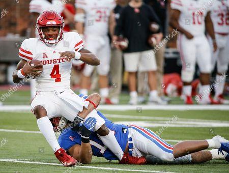 SMU linebacker Richard Moore (14) sacks Houston quarterback D'Eriq King (4) during the first half of an NCAA college football game, in Dallas