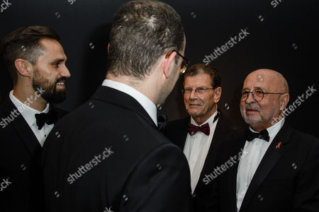 German Health Minister Jens Spahn (2-L) and his partner Daniel Funke (L) and hosts Alard von Rohr (3-L) and Alfred Weiss (R) talk during the 25th Opera Gala of the German Aids Foundation in Berlin, Germany, 03 November 2018. The gala is one of the most important charity events to be hosted in the German capital.