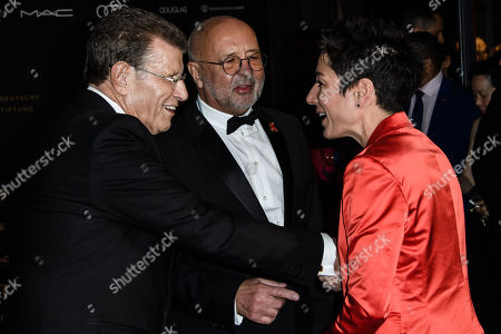 German journalist Dunja Hayali (R) and hosts Alard von Rohr (L) and Alfred Weiss (C) talk during the 25th Opera Gala of the German Aids Foundation in Berlin, Germany, 03 November 2018. The gala is one of the most important charity events to be hosted in the German capital.