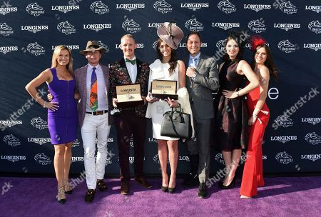Mattias Dylan Horseman, center left, of Austin, Texas, and McKenzie Marcinek, center right, of Lexington, Ky., pose with judges Jane Motion, daughter of Kentucky Derby-winning trainer Graham Motion, TV personality Carson Kressley, Pascal Savoy, Brand President for Longines US, Bri Mott, of Fashion at the Races, and Sophie Flay, daughter of Bobby Flay, after they won the Longines Prize for Elegance contest at the 2018 Breeders' Cup, at Churchill Downs in Louisville, Ky. Longines, the Swiss watch manufacturer known for its elegant timepieces, is the Official Watch and Timekeeper of the Breeders' Cup World Championships