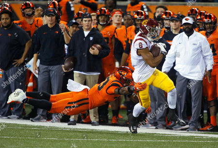 Stock Photo of Southern California's Amon-Ra St. Brown (8) pulls away from Oregon State's Jalen Moore, left, after making a reception in the first half of an NCAA college football game in Corvallis, Ore