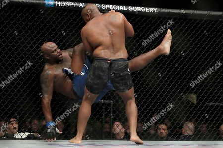Daniel Cormier, right, drops Derrick Lewis during the second round of a heavyweight mixed martial arts bout at UFC 230, early, at Madison Square Garden in New York. Cormier won by submission in the second round