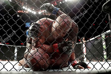 Stock Picture of Daniel Cormier, top, fights with Derrick Lewis during the first round of a heavyweight mixed martial arts bout at UFC 230, early, at Madison Square Garden in New York. Cormier won by submission in the second round